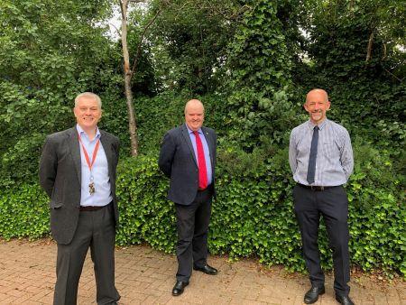 David Mallinson congratulating new directors Matthew Hidderley and Steve Brown